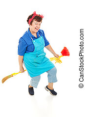 Housekeeper Riding Broom - Happy, smiling maid riding her...
