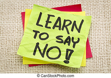 learn to say no advice or reminder on a green sticky note...