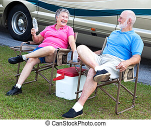 RV Seniors - Camping Fun - Senior campers sitting in folding...