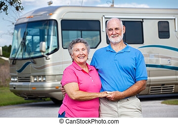 Seniors and Luxury Motor Home - Active retired couple in...