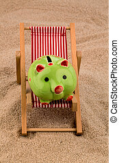 deck chair with piggy bank on the sandy beach symbol photo...