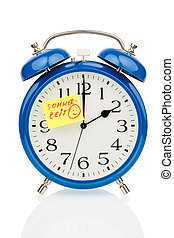 changeover to summer time - an alarm clock with a note as a...