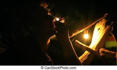 Man smoking cigar at night bar with his friends. HD....