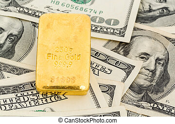 gold bars on dollar bills, symbolic photo for gold reserves,...