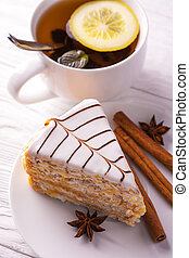 sweet almond cake and cup of tea - delicious almond cake and...