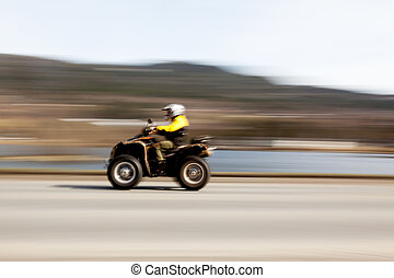 Quad - A quad on a road with motion blur