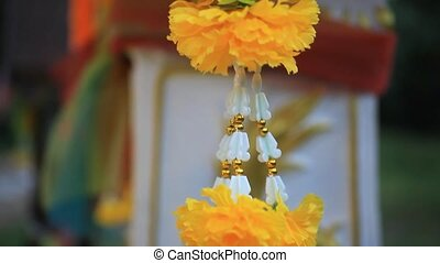 Necklace of chrysanthemums weighs on sacred temple in...