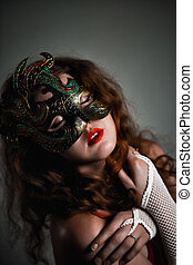 Beautiful Girl in Carnival mask with long curly hair. Masquerade Holidays
