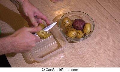 Chef peeling potatoes 4K - Chef peeling potatoes Shot in 4K...