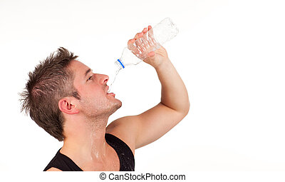 man drinking water after a gym workout