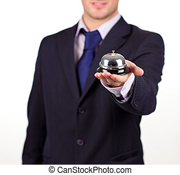 waiter holding a hotel bell - Young attractive waiter...