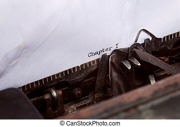 and quot;chapter one and quot; written on a typewriter -...