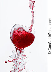 Red Wine Pouring into glass