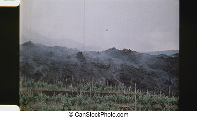 Advancing lava destroying crops - Advancing lava rock...