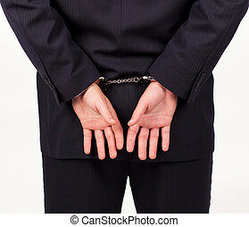Businessman in hand cuffs - Businessman tied up in hand...