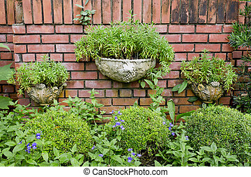 Plants on a red brick wall