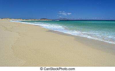 Beach at Corralejo, Fuerteventura Island. Isla de Lobos in...