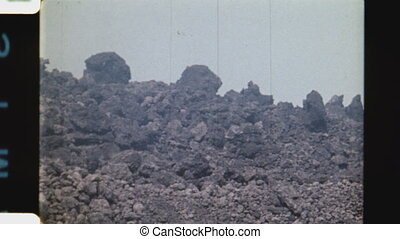 Advancing lava on mountainside. - Advancing lava rock...