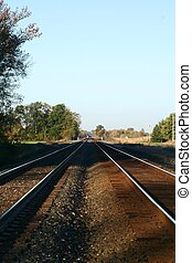 Rail Road Tracks - A pair of rail road tracks on either side...