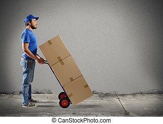 Courier - A man carries boxes in a cart