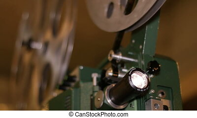 Film Projector Projecting Movie - A technician projects a...