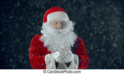 Winter Air Kiss - Man in Santa Claus costume catching...