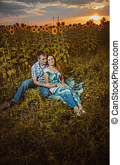 Beautiful couple having fun in sunflowers fields - Beautiful...