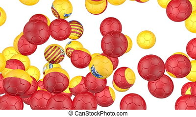 Spain flag of soccer balls - Soccer balls is falling down on...
