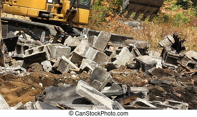 Cinderblocks and mini excavator. - Mini excavator clearing...