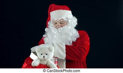 Holiday Preparations - Santa Claus slinging gift sack and...