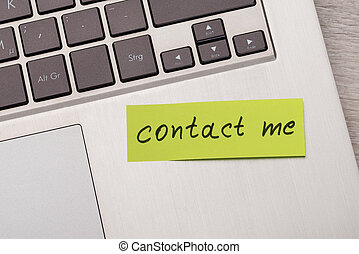 Contact Me Sticky Note On Laptop - Closeup of Contact Me...