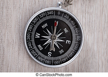 Compass On Wooden Table - Top down view of compass on wooden...