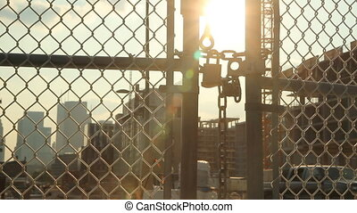 Construction site. End of the day. - Locked gate at...