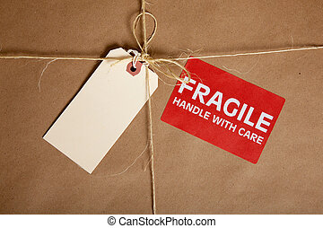 A Shipping box with a blank tag and a Fragile Sticker - A...
