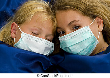 two girls sick in bed - two girls with protective masks sick...