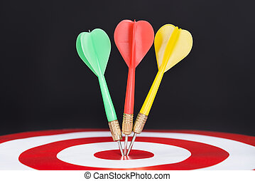 Closeup Of Darts On Target