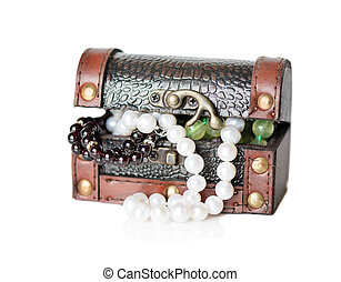 Gems in the open wooden chest - Wooden chest with jewels on...