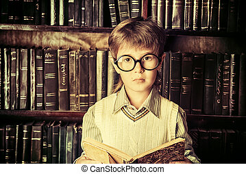 aristocrat boy - Smart boy stands in the library by the...
