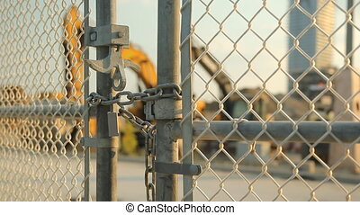 Locked gate at worksite. Machinery. - Locked gate at...