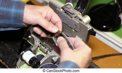 Film Technician Cutting 35mm Film - A technician cuts a 35mm...