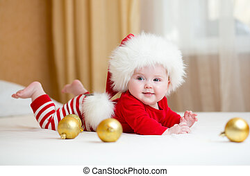 Cute Baby girl weared Christmas clothes at home