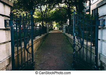 Gate and brick path at the Waterfront Park in Charleston,...