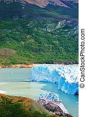 Colossal Perito Moreno glacier in Lake Argentino, surrounded...