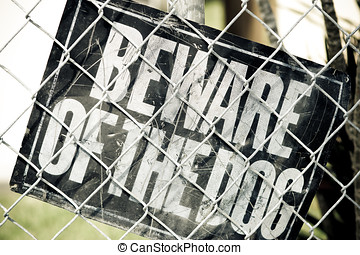 Dog Warning - Beware of the Dog Sign inside a fenced urban...