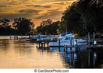 Sunset over boats docked in Duck Creek in Essex, Maryland.