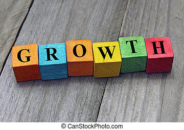 concept of growth word on wooden colorful cubes