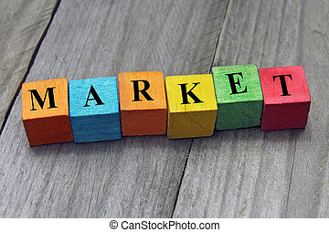 concept of market word on wooden colorful cubes