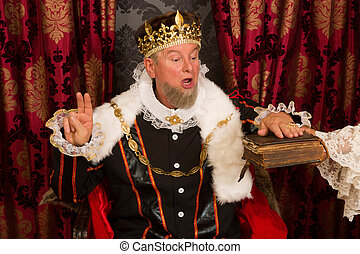 Oath on the bible - Royal king swearing a solemn oath at his...