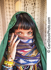 Young woman with a veiled face.