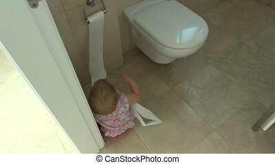 baby playing with toilet paper - baby one year old barefoot...